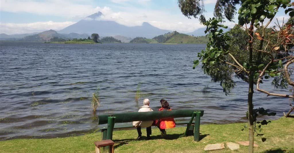 A couple enjoying an amazing view at Lake Mutanda
