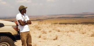Frank on Safari Watching the wildebeest Migration in Mara from a Distance
